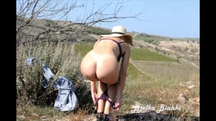 depraved-milf-fucks-herself-with-a-dildo-in-nature-a-stranger-notices-her-and-fucks-her-hard