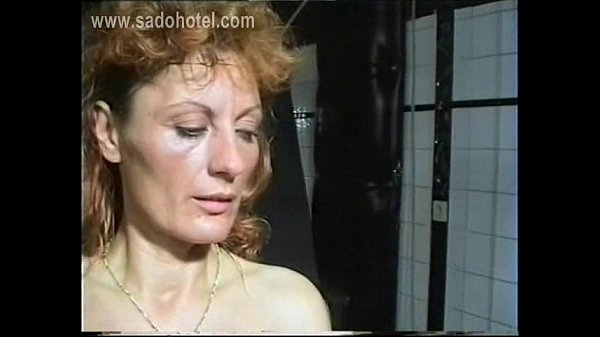 horny-milf-slave-with-her-nipples-and-clit-pierced-is-spanked-on-her-well-formed-ass