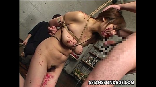 asian-slut-has-a-cock-to-suck-as-shes-tied-up