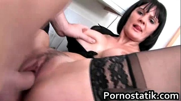 black-haired-cougar-in-black-stockings
