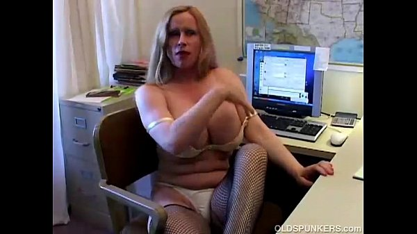 busty-cougar-in-fishnet-stockings