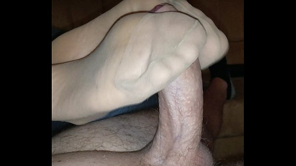 homemade-nylon-footjob-with-cumshot-over-her-stinky-feet