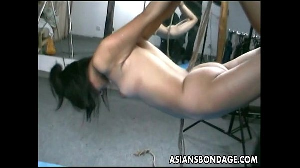 asian-lass-is-h-around-during-her-bdsm-session