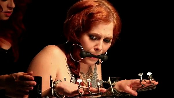 gagged-redhead-babe-in-bondage-device-gets-spanked