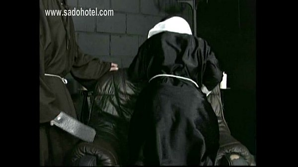 naughty-nun-kneeling-on-a-chair-with-her-dress-up-and-panties-down-is-spanked-on-her-well-formed-ass